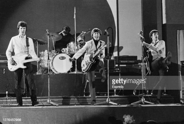 British band the Spencer Davis Group perform at the Daily Express Record Star Show, UK, 3rd April 1966. From left to right, they are guitarist Steve...