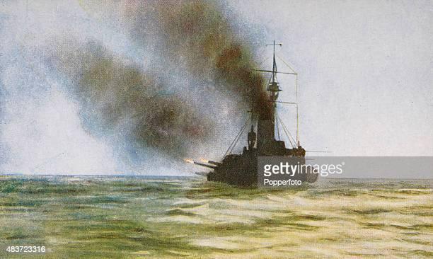 A British battleship firing salvoes at sunset on the North Sea during World War One circa 1916