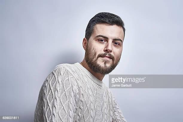 British bearded greying male smiling