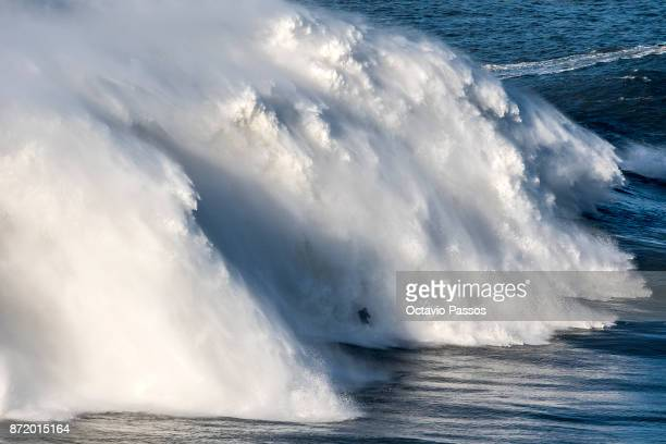 British big wave surfer Andrew Cotton drops a wave during a surf session at Praia do Norte on November 8 2017 in Nazare Portugal Cotton suffered a...