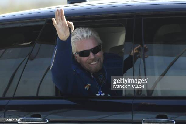 British billionaire Richard Branson is welcomed as he arrives at Spaceport America near Truth or Consequences, New Mexico, July 11, 2021 hours before...