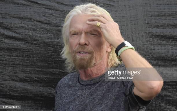 British billionaire Richard Branson stand on the stage where a Venezuelan opposition charity concert organized by him called Venezuela Aid Live will...