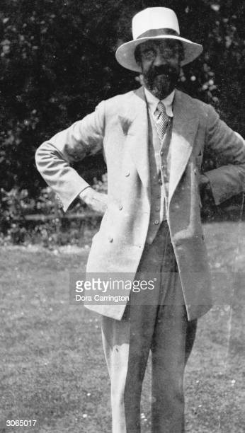 British biographer and literary critic Lytton Strachey at Ham Spray in Wiltshire the home he shared with painter Dora Carrington and associated with...