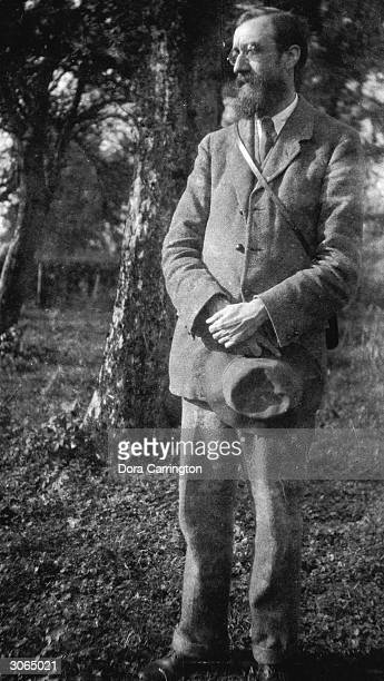 British biographer and literary critic Lytton Strachey at Ham Spray Wiltshire the home he shared with painter Dora Carrington and associated with...