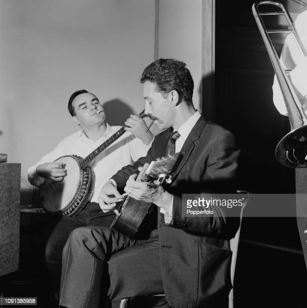 British blues guitarist and musician Alexis Korner pictured rehearsing with banjo player Eddie Smith prior to performing on the BBC Radio series...