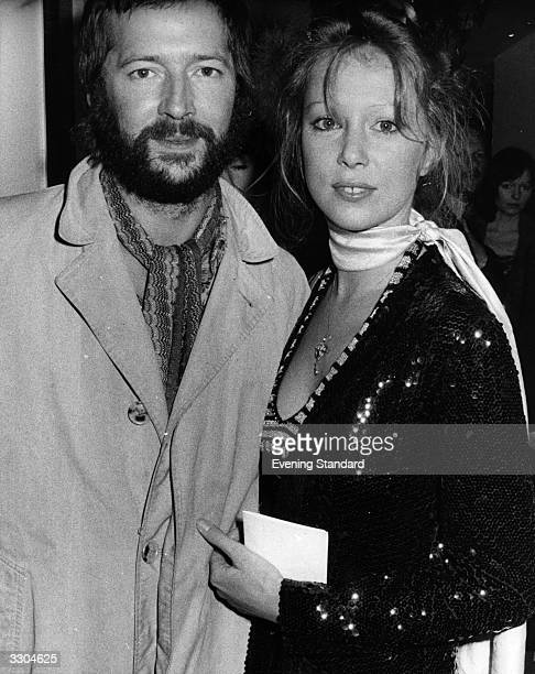 British bluesrock guitarist Eric Clapton and his girlfriend fashion model Patti Boyd exwife of exBeatle George Harrison pictured at the premiere of...