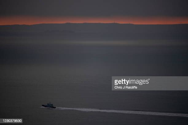 British Border Force boat patrols the English Channel near the port of Dover as the sun rises over France in the distance on January 1, 2021 in...