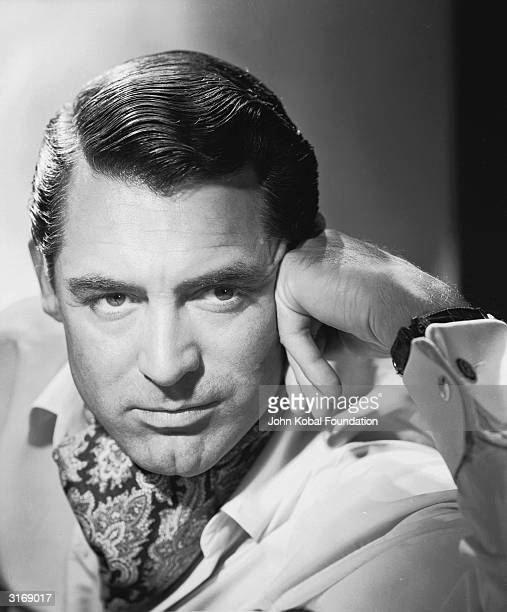 British born actor Cary Grant , renowned for his unique combination of sophisticated charm and comedic flair.
