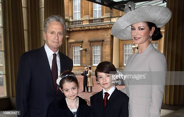 British born actress Catherine ZetaJones arrives with her husband US actor Michael Douglas and their children Dylan and Carys at Buckingham Palace in...