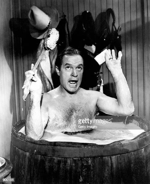 British born American actor and comedian Bob Hope takes a bath August 8 1952