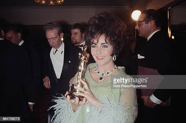 British born American actress Elizabeth Taylor pictured holding her Academy Award or 'Oscar' awarded for Best Actress in the film 'Who's Afraid of...
