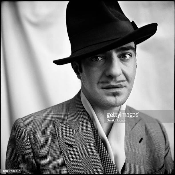 British born fashion designer John Galliano poses for a portrait in his eleventh arrondissement Paris atelier wearing a double breasted Prince of...