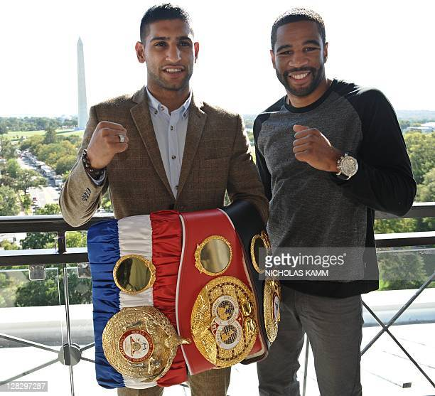 British boxer Amir Khan and Lamont Peterson of the US pose for photographers after a press conference in Washington on October 6 2011 to announce...