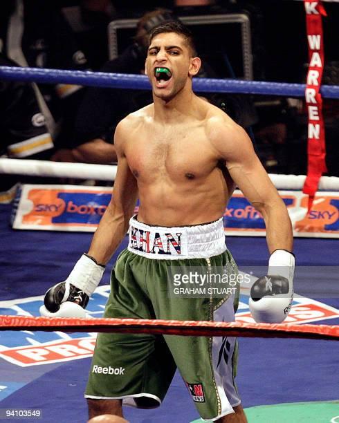 British boxer Amir Khan celebrates beating Ukrainian born Dmitriy Salita of US and winning in the first round during their WBA lightwelterweight...