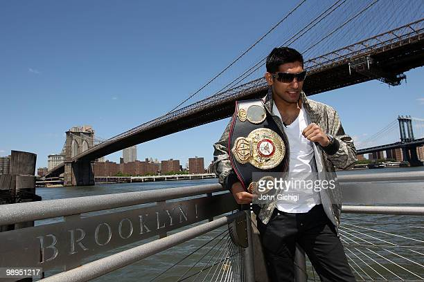 British boxer Amir Khan poses with the WBA World light welterweight championship belt in front of the Brooklyn Bridge on May 10, 2010 in the Brooklyn...
