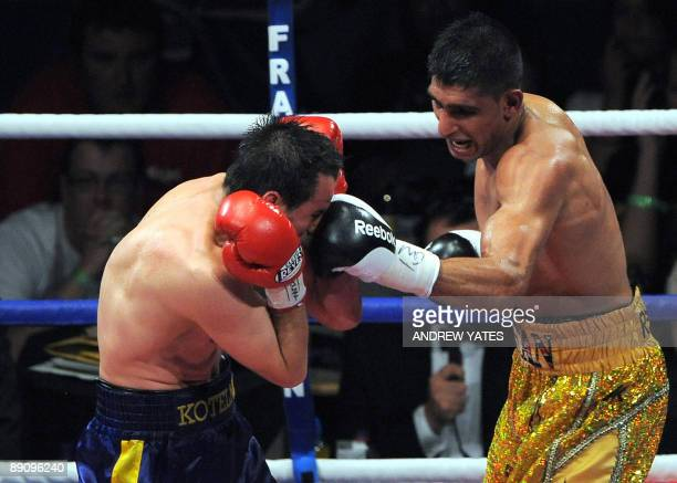British boxer Amir Khan punches Ukrainian boxer Andreas Kotelnik during their WBA light-welterweight championship boxing match on July 18, 2009 at...