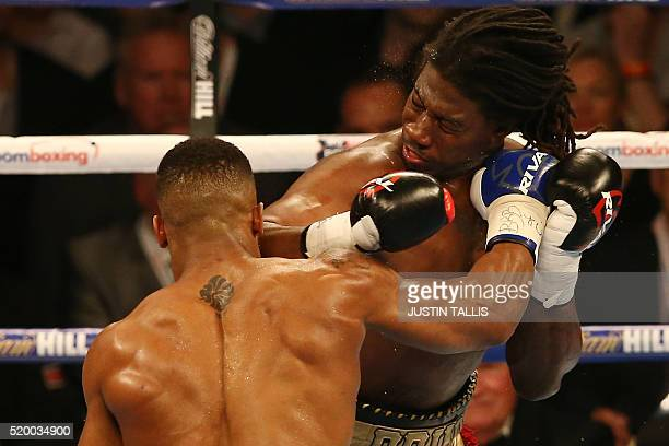 British boxer Anthony Joshua and US boxer Charles Martin vie during their IBF World Heavyweight title boxing match at the O2 arena in London on April...