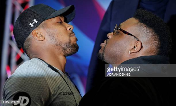 British boxer Anthony Joshua and US boxer Jarrell Miller pose during a joint press conference in London on February 25 ahead of their forthcoming IBF...