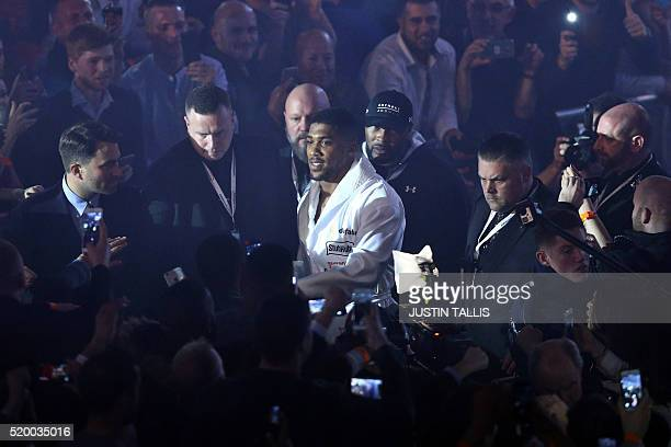 British boxer Anthony Joshua arrives to fight US boxer Charles Martin in their IBF World Heavyweight title boxing match at the O2 arena in London on...
