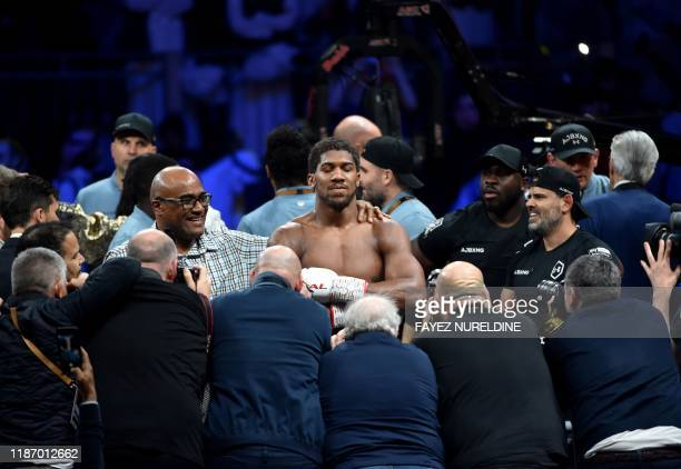 British boxer Anthony Joshua celebrates after winning the heavyweight boxing match between Andy Ruiz Jr. And Anthony Joshua for the IBF, WBA, WBO and...