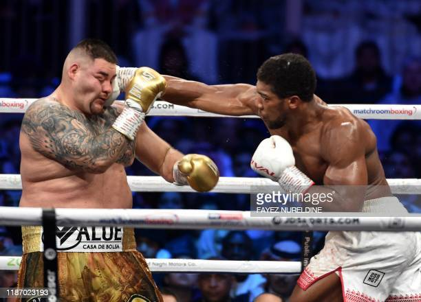 TOPSHOT British boxer Anthony Joshua competes with MexicanAmerican boxer Andy Ruiz Jr during the heavyweight boxing match between Andy Ruiz Jr and...