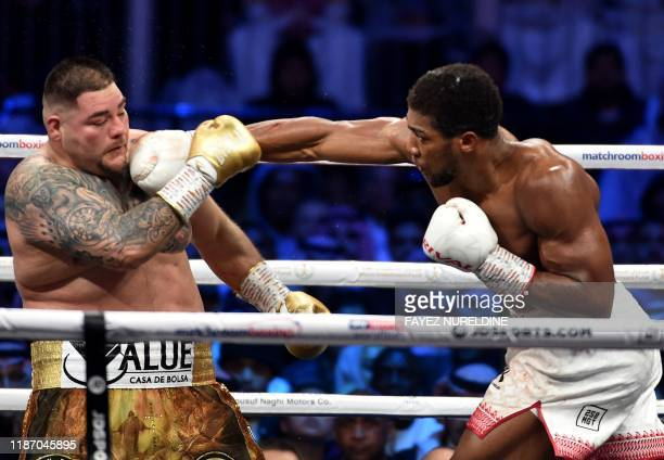 British boxer Anthony Joshua competes with MexicanAmerican boxer Andy Ruiz Jr during the heavyweight boxing match between Andy Ruiz Jr and Anthony...