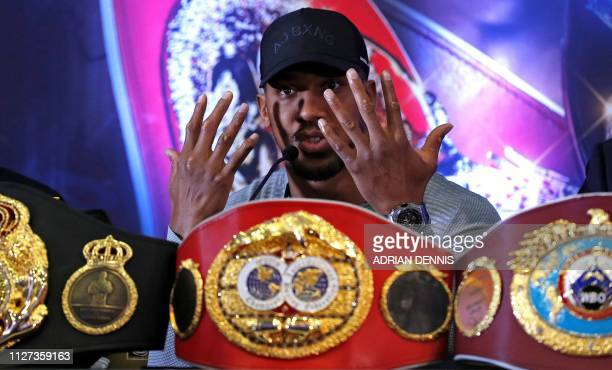 British boxer Anthony Joshua speaks during a press conference in London on February 25 ahead of his forthcoming IBF, WBA and WBO heavyweight title...
