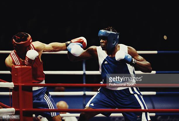 British boxer Audley Harrison pictured on right in action to win the gold medal in the final of the Men's Super heavyweight boxing event against...