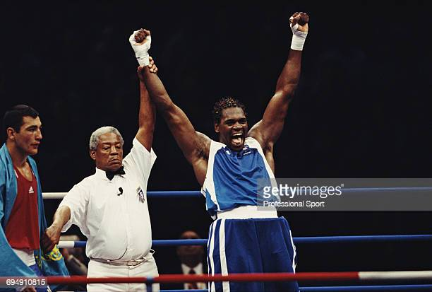 British boxer Audley Harrison raises his arms in the air after winning the gold medal in the final of the Men's Super heavyweight boxing event...