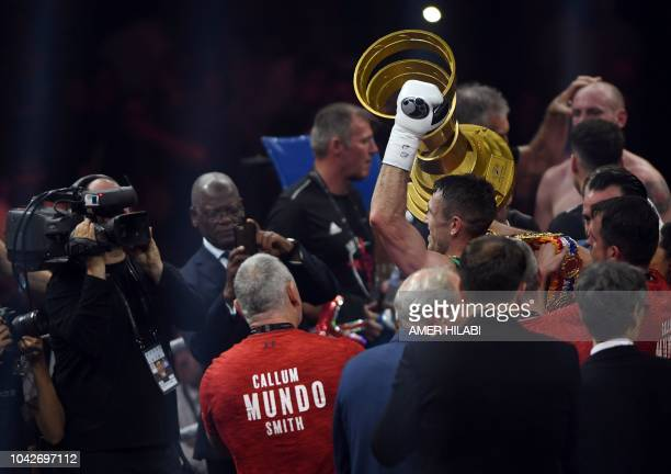 British boxer Callum Smith celebrates with the trophy after defeating compatriot George Groves during the World Boxing Super Series SuperMiddleweight...