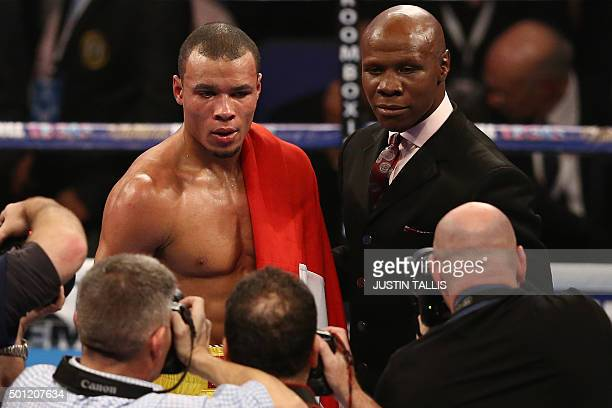 British boxer Chris Eubank Jr and his father and manager English aka former boxing champion Chris Eubank Snr pose for photographers in the ring after...