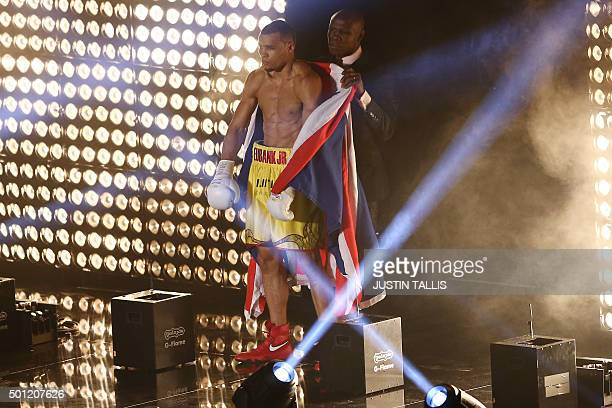 British boxer Chris Eubank Jr walks out with his father and manager English aka former boxing champion Chris Eubank Snr to fight against Irish boxer...