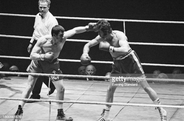 British boxer Chris Finnegan takes on Welsh boxer Royston 'Roy' John at the Empire Pool in Wembley, London, UK, for the Commonwealth and British...