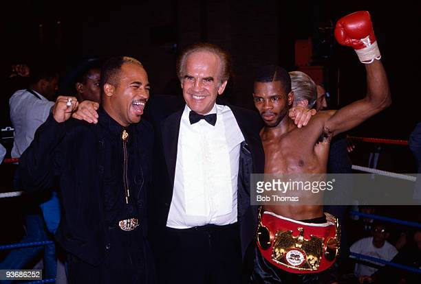 British boxer Duke McKenzie celebrates with his manager Mickey Duff and Lloyd Honeyghan after beating Rolando Bohol to win the IBF world flyweight...