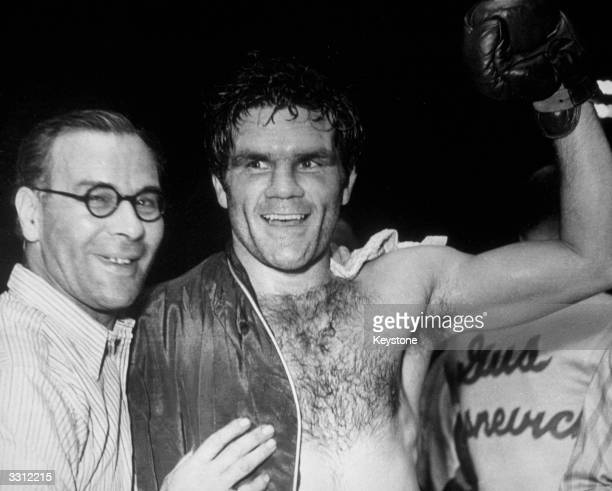 British boxer Freddie Mills celebrates after his world lightheavyweight title victory over US boxer Gus Lesnevich 1st July 1948
