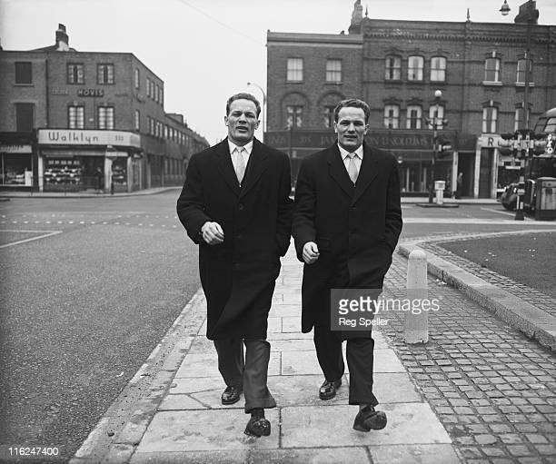 British boxer Henry Cooper and his twin brother George arriving for a training session at the Thomas a Becket gym on the Old Kent Road South London...