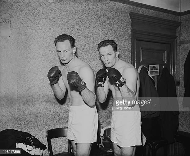 British boxer Henry Cooper and his twin brother George during a training session at the Thomas a Becket gym on the Old Kent Road South London 18th...