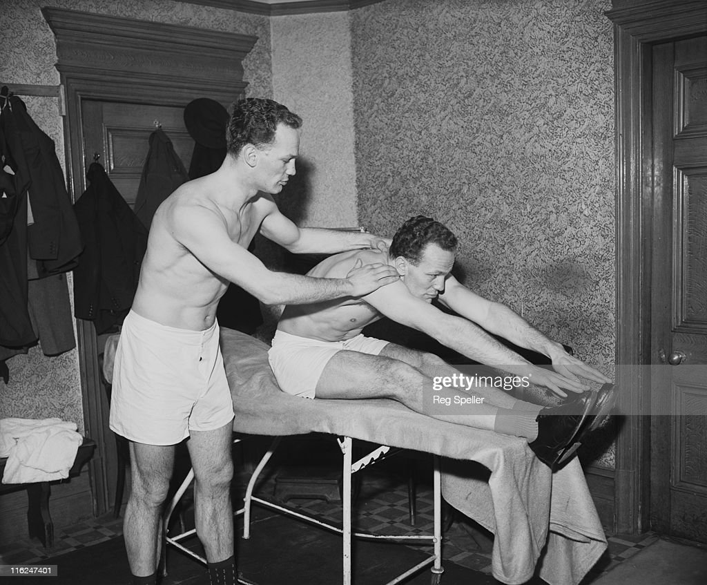 British boxer Henry Cooper (1934 - 2011, right) and his twin brother George (1934 - 2010), during a training session at the Thomas a Becket gym on the Old Kent Road, South London, 18th March 1958. George boxed using the name Jim Cooper.