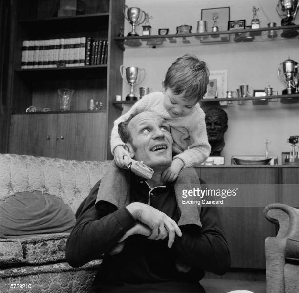 British boxer Henry Cooper at home with his son John Pietro 25th March 1970
