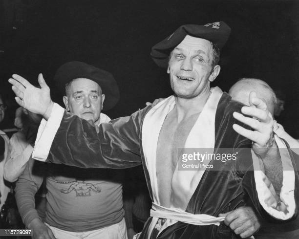 British boxer Henry Cooper celebrates regaining the European heavyweight title after beating Jose Manuel Urtain of Spain in nine rounds at the Empire...