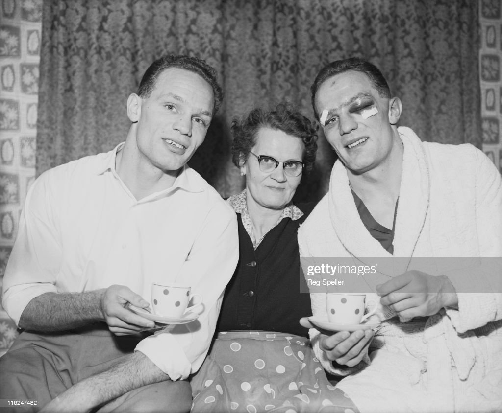 British boxer Henry Cooper (1934 - 2011, right) with his twin brother George (1934 - 2010), and their mother Lily at their home in Bellingham, south London, 13th January 1959. Henry is injured after his previous night's fight against Brian London, in which he won the Commonwealth (British Empire) heavyweight title. George boxed using the name Jim Cooper.
