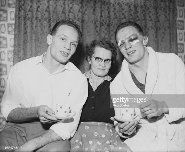British boxer Henry Cooper with his twin brother George and their mother Lily at their home in Bellingham south London 13th January 1959 Henry is...