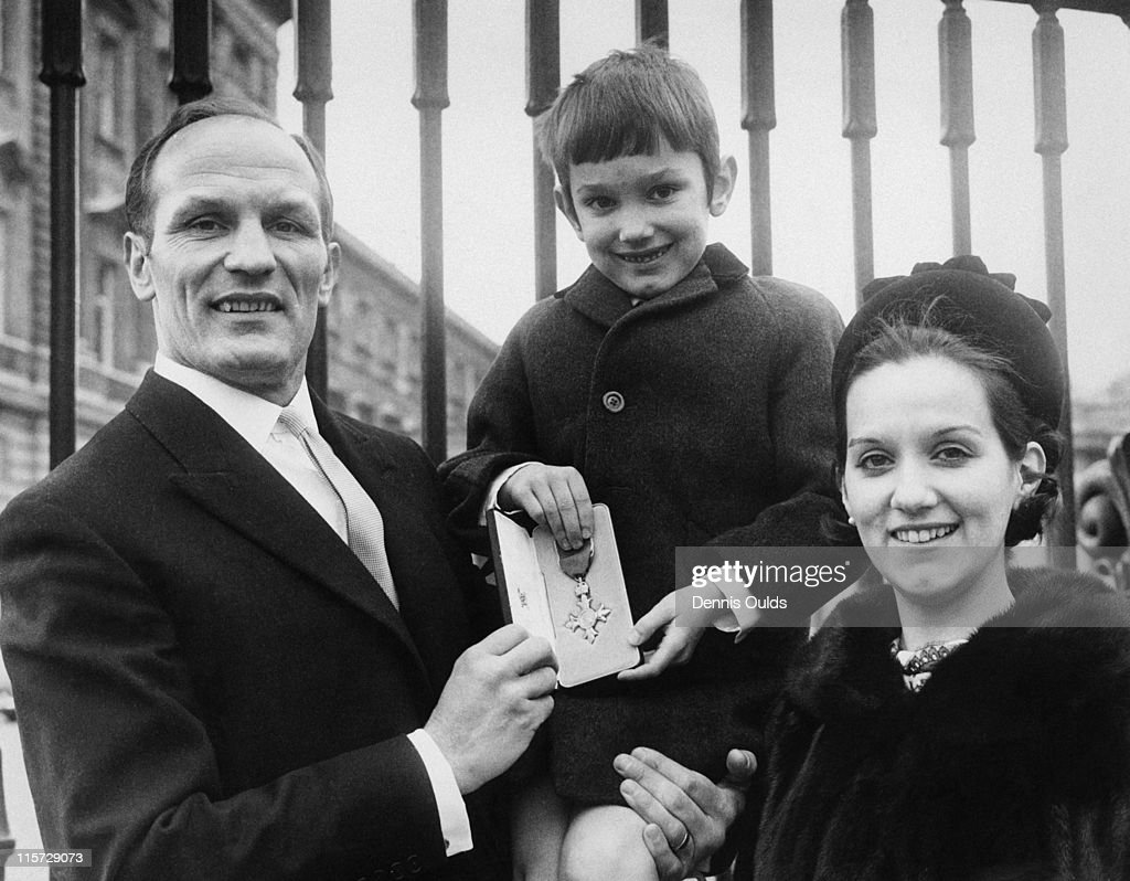 British boxer Henry Cooper (1934 - 2011), with his wife Albina and son Henry Marco, after receiving his OBE at Buckingham Palace, London, 11th February 1969.