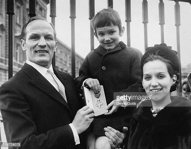 British boxer Henry Cooper with his wife Albina and son Henry Marco after receiving his OBE at Buckingham Palace London 11th February 1969