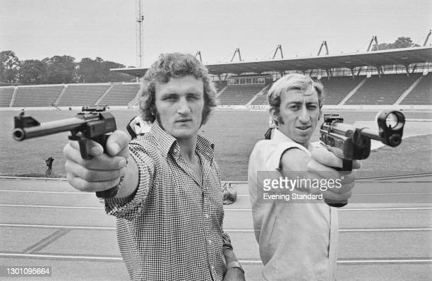 British boxer Joe Bugner and athlete David Hemery take part in the televised sporting event 'Superstars' at Crystal Palace athletics stadium in...