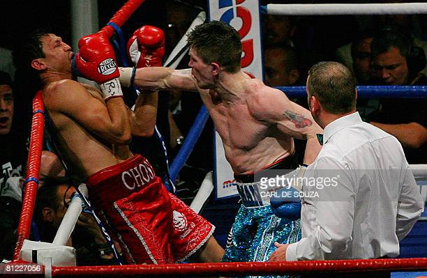 British Boxer Ricky Hatton and Mexican boxer Juan Lazcano vie during their Light Welterweight boxing Championship of the world title bout at City of...