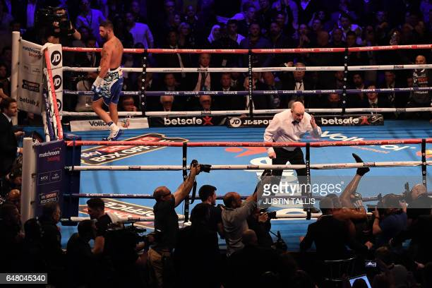 British boxer Tony Bellew stands in his corner whilst the referee counts out rival and British compatriot David Haye after Bellew punched him through...