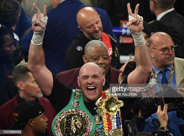 British boxer Tyson Fury celebrates after defeating US boxer Deontay Wilder in the seventh round during their World Boxing Council Heavyweight...
