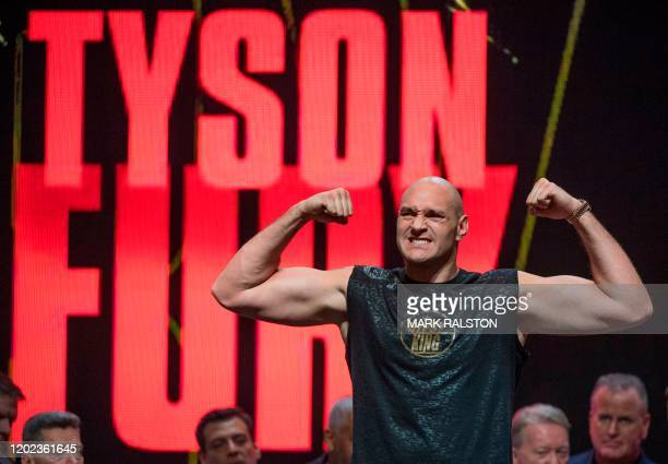 British boxer Tyson Fury flexes during his official weighin before his heavyweight boxing fight against US boxer Deontay Wilder at the MGM Grand Las...
