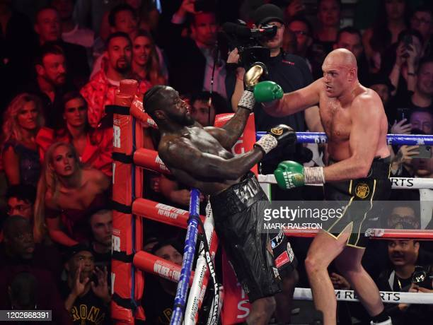 British boxer Tyson Fury has US boxer Deontay Wilder against the ropes before defeating him in the seventh round during their World Boxing Council...